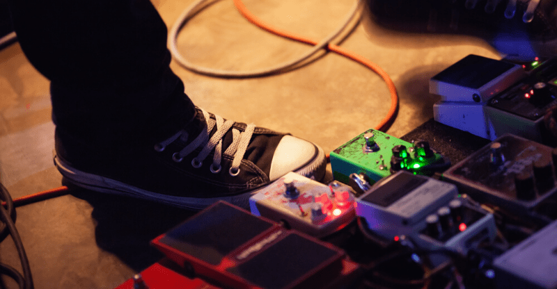 guitarist with effects pedals