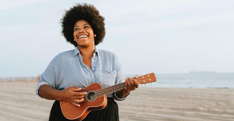 woman playing ukulele