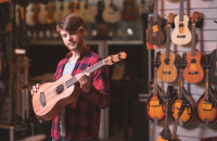 guy in ukulele shop