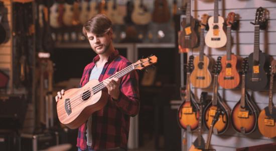 guy in ukulele shop