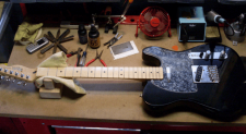 picture of telecaster being cleaned
