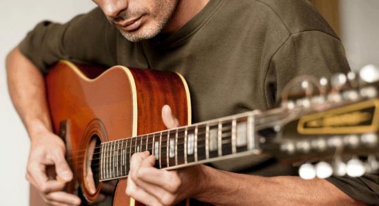 guy playing 12 string guitar