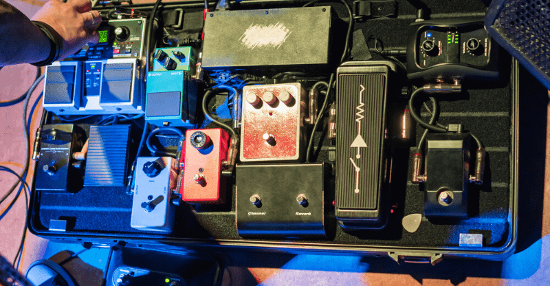 person adjusting pedalboard