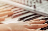 person playing a midi keyboard