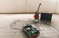 guitar and pedals in warehouse