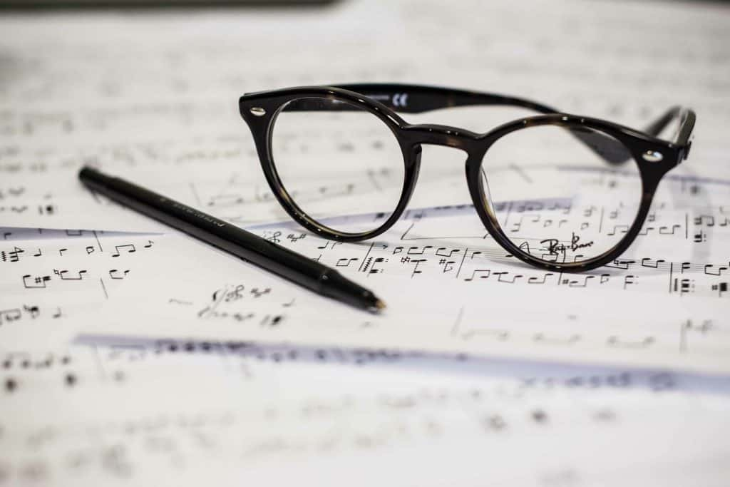 picture of sheet music and glasses