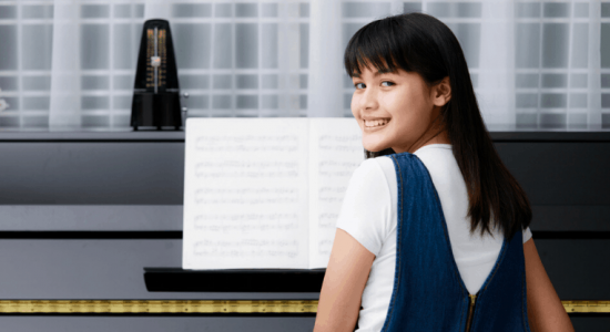 girl playing piano with metronome