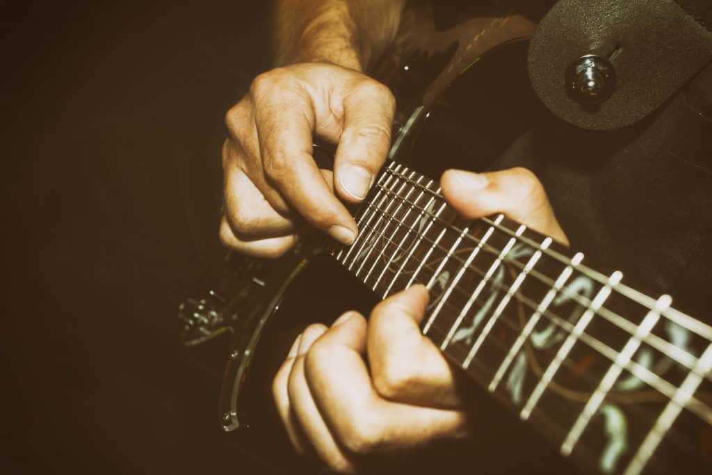 picture of fingers on frets