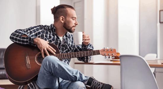guy practicing guitar