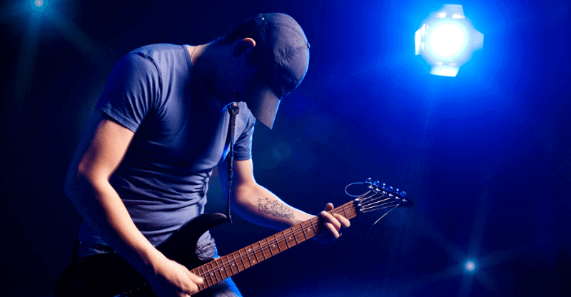 guy with guitar blue light