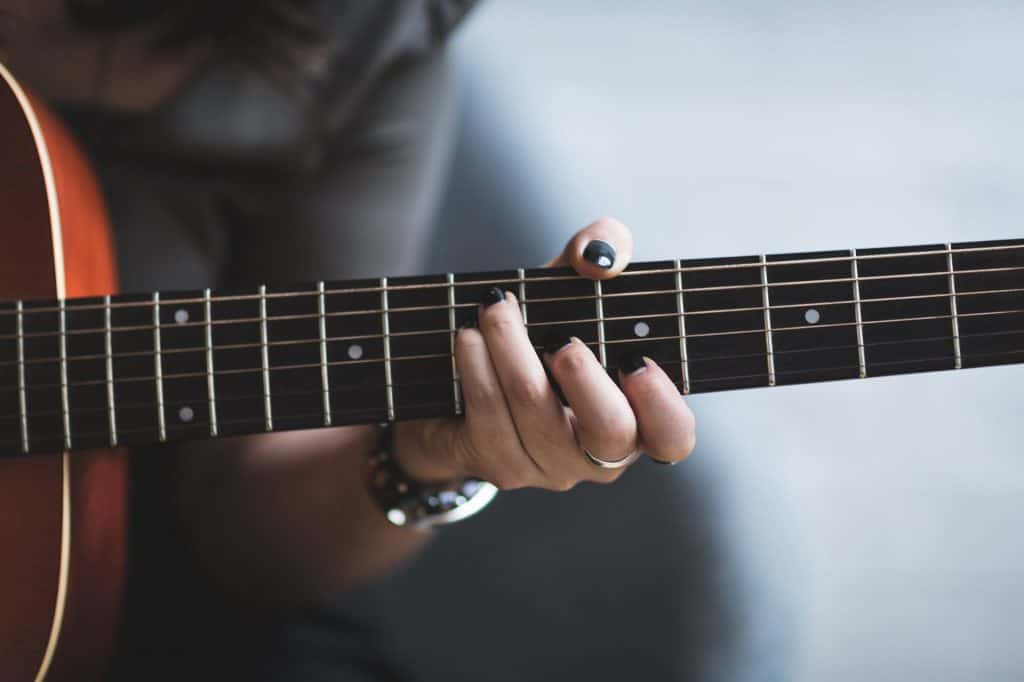 picture of guitarist playing a chord