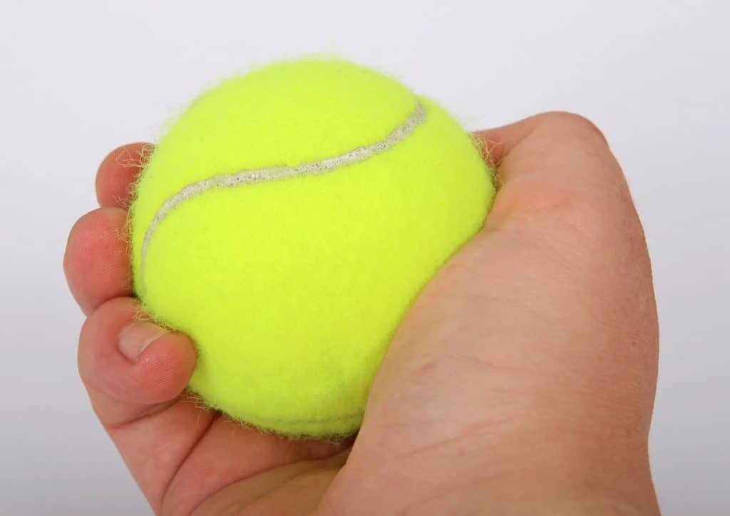 picture of hand squeezing tennis ball