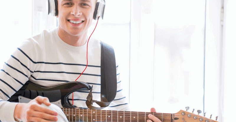 guy with headphones and guitar