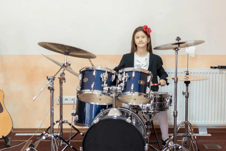 Girl playing drum kit