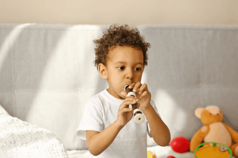 Young boy playing the recorder