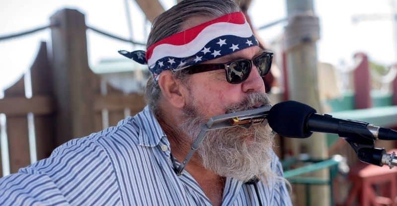 man playing harmonica