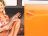 girl playing ukulele in campervan