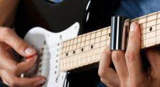 man playing slide on electric guitar