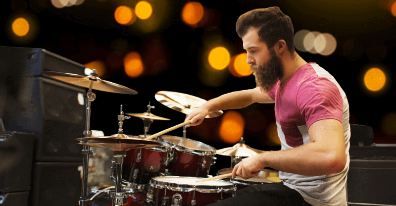bearded guy playing drums