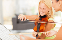 girl being taught violin