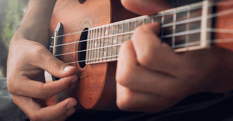 plucking ukulele