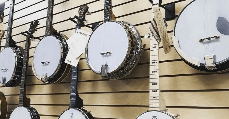 collection of banjos on wall