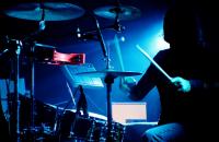dark lit drummer