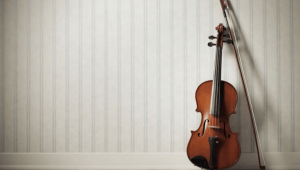 violin and bow against wall