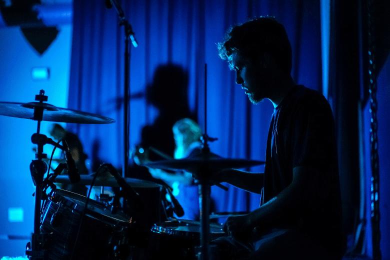 Drummer in blue room
