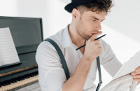Man looking at sheet of music
