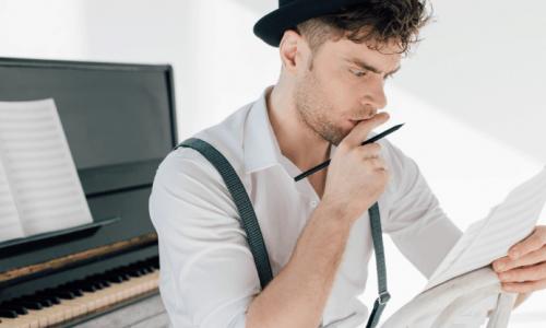 Man looking at sheet of music