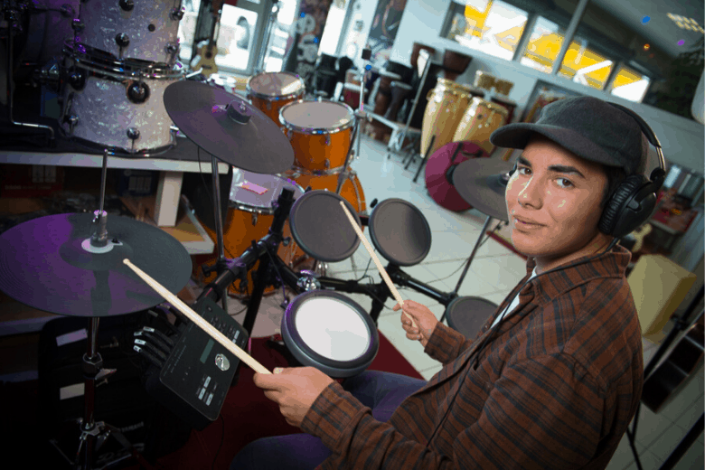 Young guy electronic drums