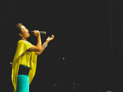 girl singing on stage