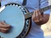guy playing banjo in street