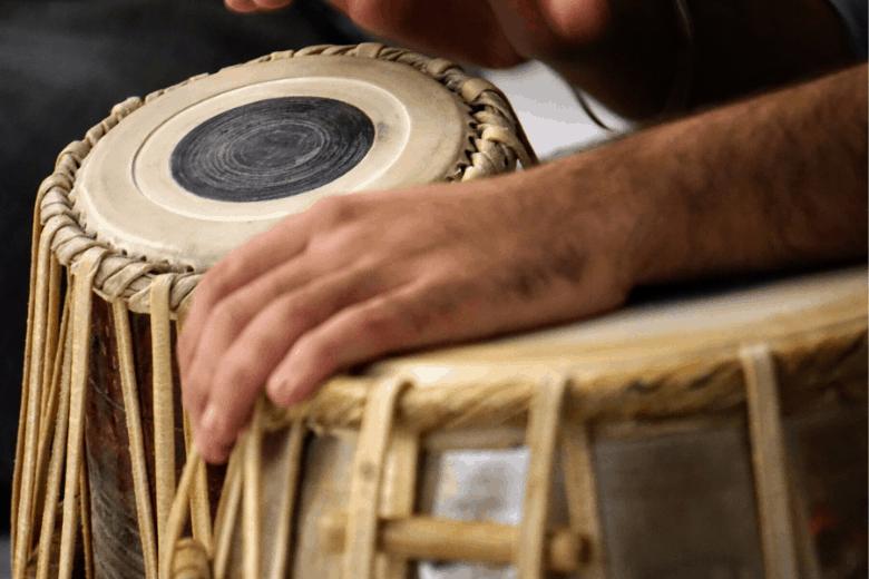 person playing tabla