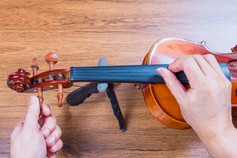 Adjusting a violin