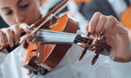Person tuning a violin