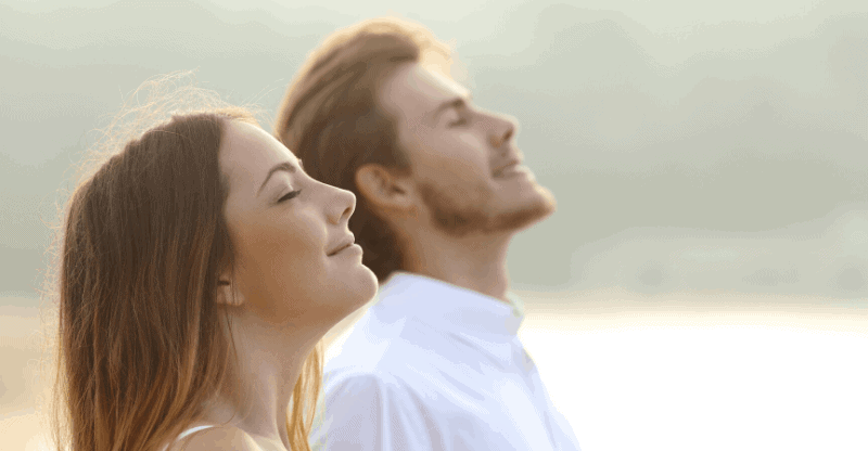man and woman doing breathing exercises