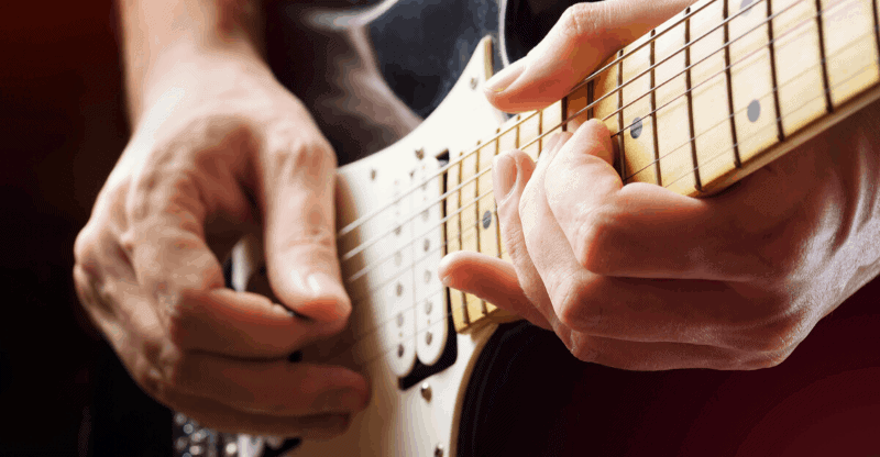 Close up guy playing a stratocaster