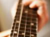 Close up of banjo fretboard