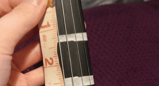 adding fingerboard tape to a violin