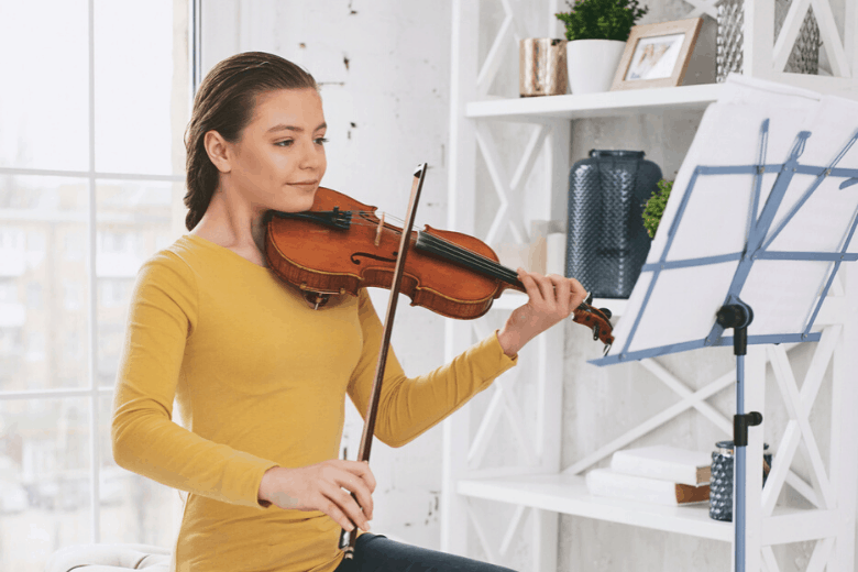 girl with good posture playing violin