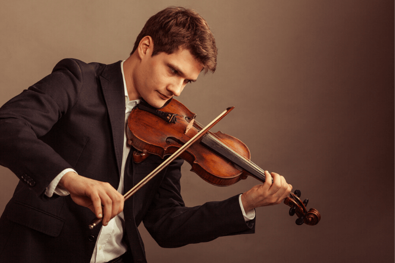 man playing classical violin