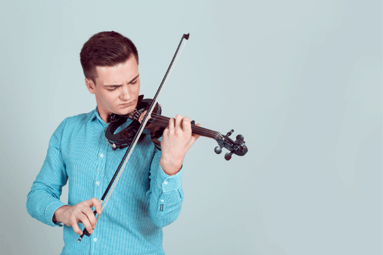 man playing violin with blue shirt