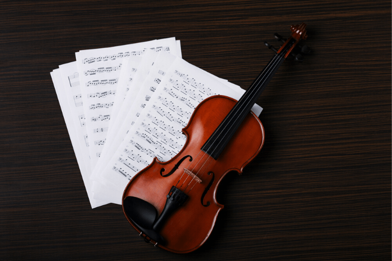 violin on top of sheet music (1)