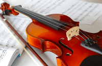 violin on top of sheet music
