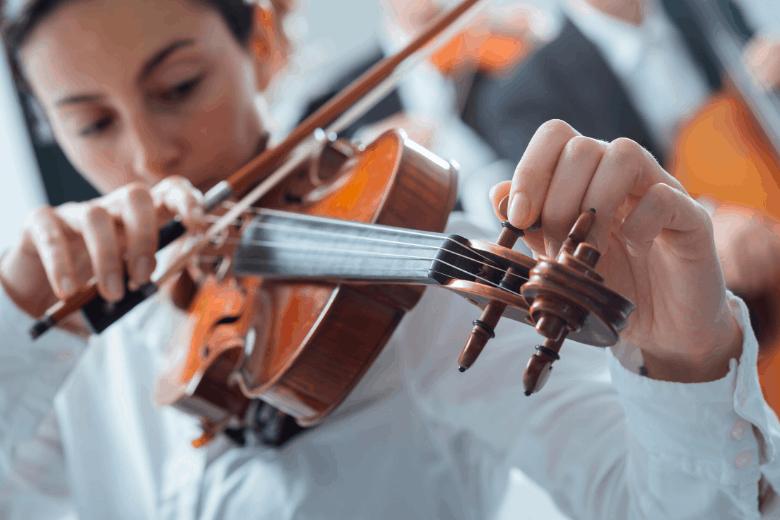 woman tuning a violin