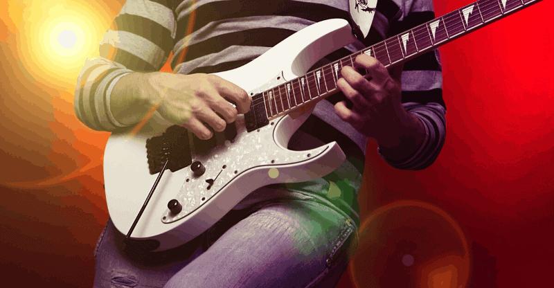 guy playing a metal guitar