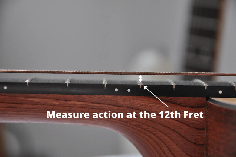 Measure action at the 12th Fret