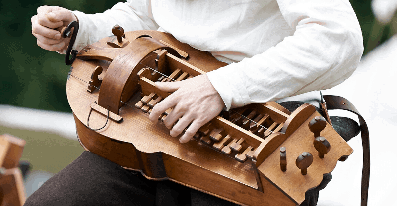 person playing a hurdy gurdy